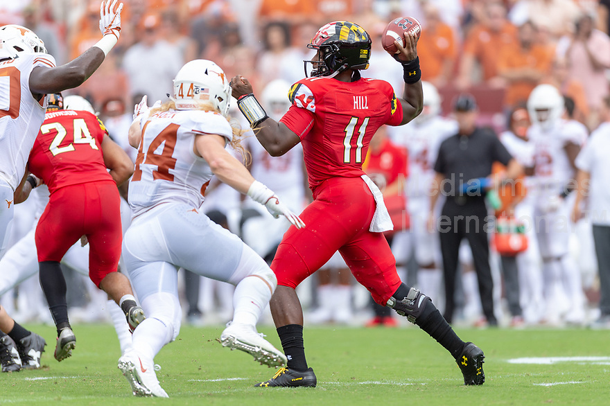 Landover, MD - September 1, 2018: Maryland Terrapins quarterback Kasim Hill (11) throws the ball from the pocket during game between Maryland and No. 23 ranked Texas at FedEx Field in Landover, MD. The Terrapins upset the Longhorns in back to back season openers with a 34-29 win. (Photo by Phillip Peters/Media Images International)