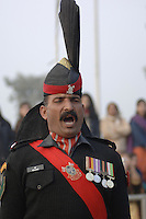 The sergeant-major bellows orders during the daily flag-lowering ceremony at Wagah on the border with India, in which Pakistani and Indian troops try to outdo each other with the extravagance of their drills.