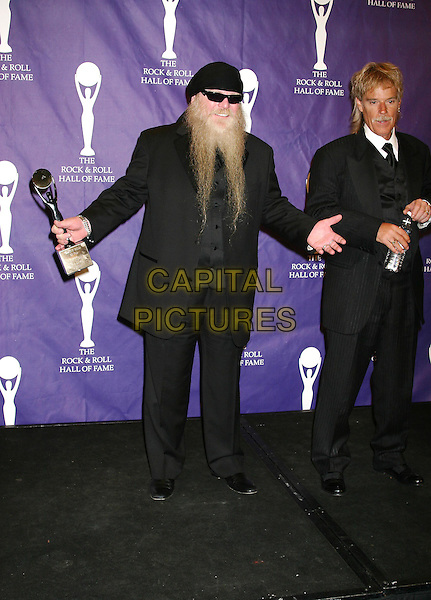 DUSTY HILL OF ZZ TOP.The 19th Annual Rock and Roll Hall of Fame Induction Ceremony Press Room at the Waldorf Astoria, New York City.15 March 2004  .*UK Sales Only*.full length, full-length.www.capitalpictures.com.sales@capitalpictures.com.©Capital Pictures.