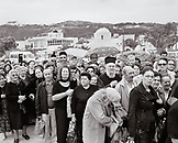 GREECE, Patmos, Skala, Dodecanese Island, people await a ferry to take them to Athens (B&W)