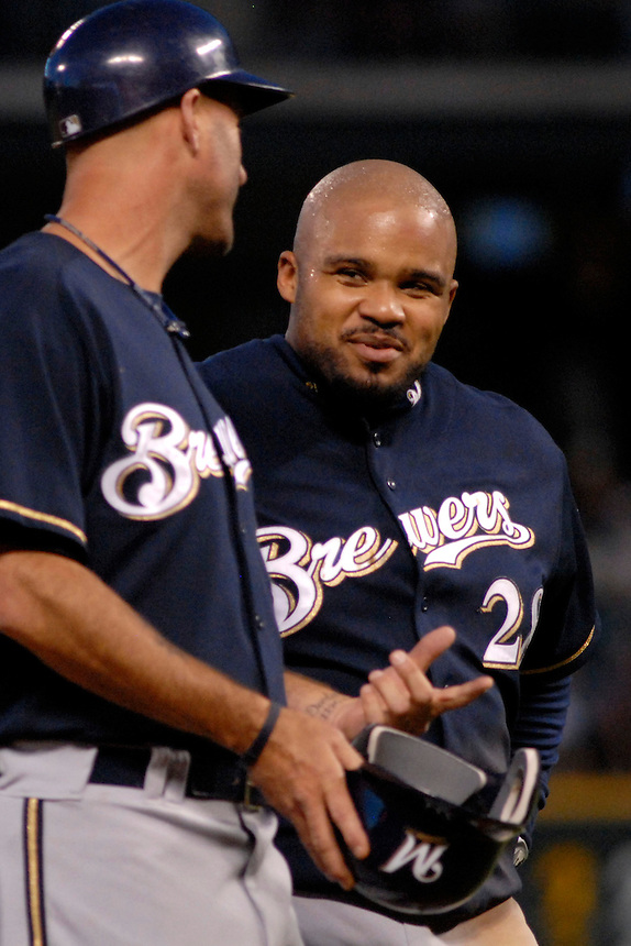 06 June 08: Milwuakee Brewers 1st baseman Prince Fielder laughs with 3rd base coach Dale Sveum between half innings of a game against the Colorado Rockies. The Rockies defeated the Brewers 6-4 at Coors Field in Denver, Colorado on June 6, 2008. For EDITORIAL use only