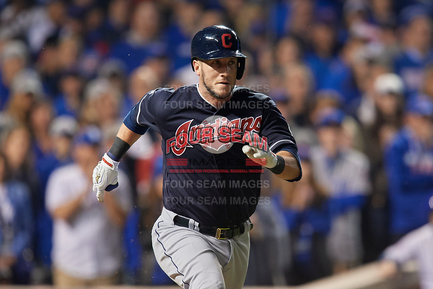 Cleveland Indians Yan Gomes (10) runs to first base in the ninth inning during Game 3 of the Major League Baseball World Series against the Chicago Cubs on October 28, 2016 at Wrigley Field in Chicago, Illinois.  (Mike Janes/Four Seam Images)