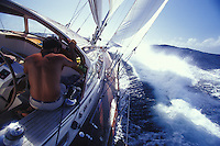 Man sailing to windward in rough seas on the Halberg-Rassy 46 yacht 'Heron', Pacific Ocean, Tahiti, French Polynesia