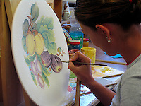 Hand painting of ceramics designs in ceramics factory in Deruta, Ital