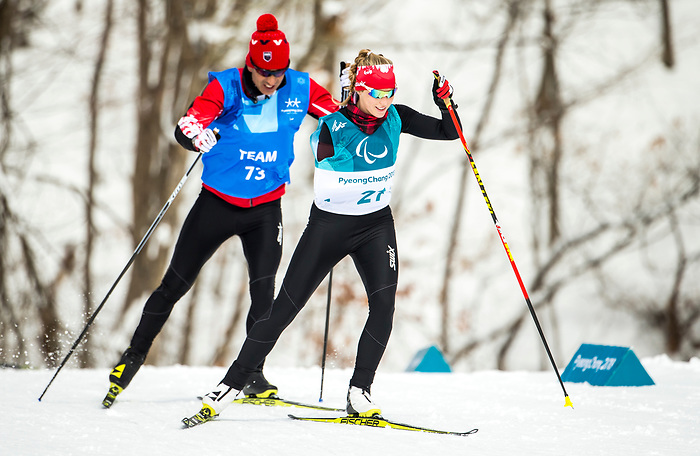 PyeongChang 9/3/2018 - Emily Young, of Kelowna, BC, and Coach Robin McKeever, of Canmore, AB, during a biathlon/cross country training session at the Alpensia Biathlon Centre during the 2018 Winter Paralympic Games in Pyeongchang, Korea. Photo: Dave Holland/Canadian Paralympic Committee