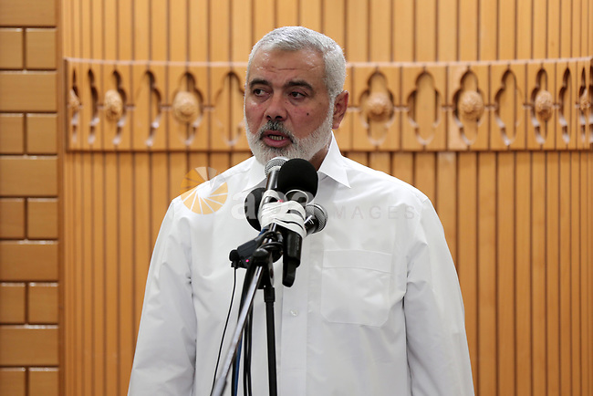 Chairman of the political bureau of the Hamas Palestinian Islamist movement, Ismail Haniyeh speaks at a mosque during the funeral of Yussef al-Faseeh, 29, who was shot dead by Israeli troops during clashes at Israel-Gaza border, in Gaza city on on 9, 2018. Four Palestinians were killed by Israeli fire on the Gaza border on June 8, the territory's health ministry said giving a new toll, as weeks of deadly clashes with protesters continued. Photo by Mahmoud Ajour