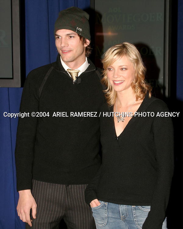 ©2004  ARIEL RAMEREZ / HUTCHINS PHOTO.AOL MOVIEGOER AWARDS NOMINATIONS .MANDARIN ORIENTAL HOTEL.NEW YORK, NY  .JANUARY 21, 2004..ASHTON KUTCHER.AMY SMART