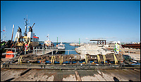 BNPS.co.uk (01202) 558833<br /> Picture: Peter Willows<br /> <br /> **Please use byline**<br /> <br /> The rudder is being temporarily stored at Poole docks, before being transported to York.<br /> <br /> A spectacular carving of the face of a moustachioed warrior today greeted archeologists as they raised part of a huge 17th century ship wreck in the English Channel. The intricate work of art was engraved into the 28ft long rudder section of the Dutch wooden trading ship that sunk off Poole, Dorset, in 1628. Its accidental discovery by a dredger led to six years of underwater investigations which prompted experts to hail the find as the most significant since the Mary Rose.