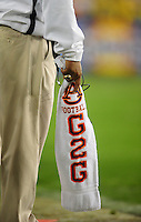 Jan 10, 2011; Glendale, AZ, USA; An Auburn Tigers coach holds a towel in his hand on the sidelines against the Oregon Ducks during the 2011 BCS National Championship game at University of Phoenix Stadium. The Tigers defeated the Ducks 22-19. Mandatory Credit: Mark J. Rebilas-
