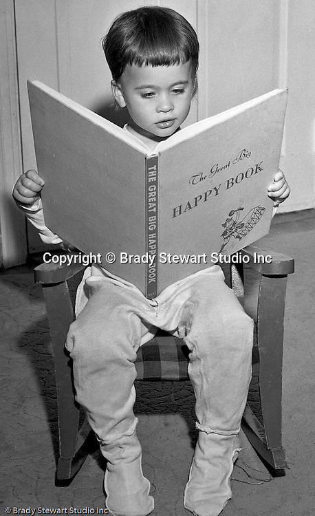 "Pleasant Hills PA:  Brady Stewart Studio participated in a national promotion for American Hardware Catalog Cover - 1950.  The contest asked for submissions to include a child reading a book at night time.  In this image, Cathleen Brady Stewart is reading the ""The Great Big Happy Book""."