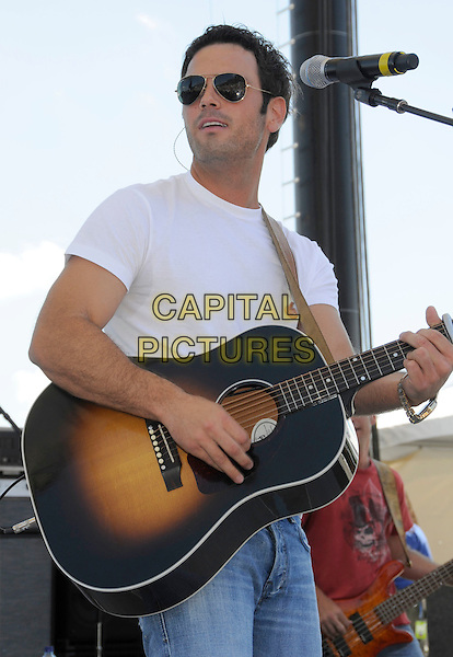 CHUCK WICKS.2008 CMA Music Festival Greased Lightning Riverfront Daytime Stage, Nashville, Tennessee, USA, .05 June 2008..country music sunglasses microphone concert gig on stage half length guitar.CAP/ADM/LF.©Laura Farr/Admedia/Capital PIctures