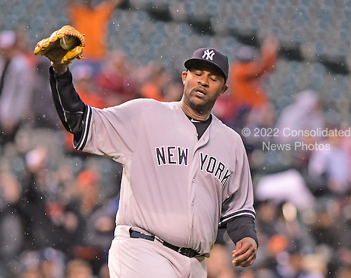 New York Yankees starting pitcher CC Sabathia (52) reacts after giving up a first inning home run to Baltimore Orioles center fielder Adam Jones (10) at Oriole Park at Camden Yards in Baltimore, MD on Tuesday, April 14, 2015. <br /> Credit: Ron Sachs / CNP<br /> (RESTRICTION: NO New York or New Jersey Newspapers or newspapers within a 75 mile radius of New York City)