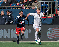 FOXBOROUGH, MA - MARCH 7: Fabian Herbers #21 of Chicago Fire brings the ball forward as Diego Fagundez #14 of New England Revolution closes during a game between Chicago Fire and New England Revolution at Gillette Stadium on March 7, 2020 in Foxborough, Massachusetts.