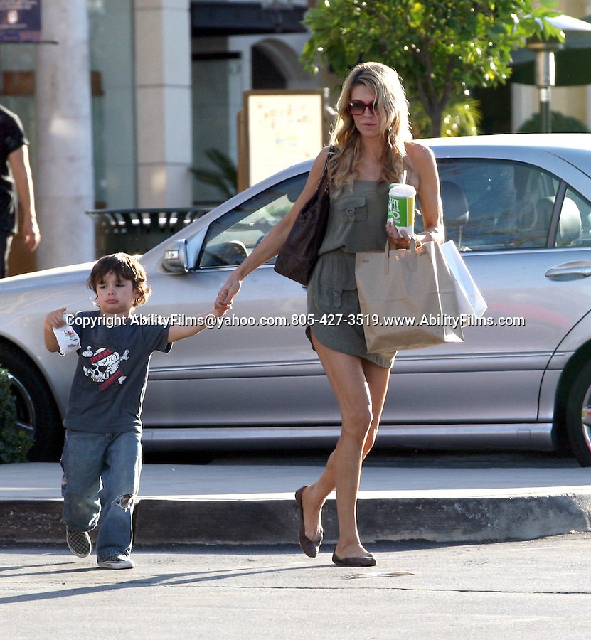 ..Feb 22nd 2012 Exclusive.Calabasas California..Brandi Glanville  laughing with her son as she cooled off his head with a nice cold drink. It was almost  90 degree's outside. Brandi picked up some food to go at La Salsa Mexican restaurant wearing a short green dress showing off her long legs ...AbilityFilms@yahoo.com.805-427-3519.www.AbilityFilms.com...