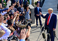 United States President Donald J. Trump gestures towards a reporter as he takes questions from reporters as he prepares to depart the South Lawn of the White House in Washington, DC to spend a week at the Trump National Golf Club Bedminster in Bedminster, New Jersey on Friday, August 9, 2019.<br /> CAP/MPI/RS<br /> ©RS/MPI/Capital Pictures