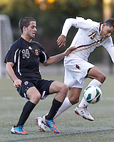 Boston College forward/midfielder Diego Medina-Mendez (15) attempts to control the ball as Brown University midfielder Michel Comitis (14) defends. Brown University (black) defeated Boston College (white), 1-0, at Newton Campus Field, October 16, 2012.
