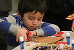 Damian Pacheco, 4, creates artwork during the Posada Celebration at Western Nevada College in Carson City, Nev., on Saturday, Dec. 16, 2017. <br />