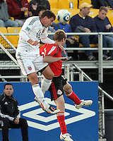Mark Burch#4 of D.C. United wins a header from Gianluca Zavarise#33 of Toronto FC during the final round of the Carolina Challenge Cup on March 12 2011 at Blackbaud Stadium in Charleston, South Carolina. D.C. The game ended in a 2-2 tie which was sufficient for D.C. United to win the tournament.