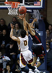 SIOUX FALLS, SD: MARCH 20:  Ian Smith #0 of Northern State shoots over East Stroudsburg defender Kitt Najee Walls #11 during their game at the 2018 Division II Men's Elite 8 Basketball Championship at the Sanford Pentagon in Sioux Falls, S.D. (Photo by Dick Carlson/Inertia)