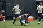 Jon Bakero (7) of the Wake Forest Demon Deacons keeps the ball away from Brendan Moyers (6) of the Virginia Tech Hokies during first half action at Spry Soccer Stadium on November 5, 2017 in Winston-Salem, North Carolina.  The Demon Deacons defeated the Hokies 3-0.  (Brian Westerholt/Sports On Film)