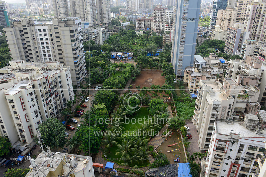 INDIA, Mumbai, green playground between skyscraper in suburb Goregoan
