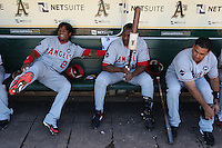 OAKLAND, CA - OCTOBER 3:  Erick Aybar #2 and Vladimir Guerrero #27 of the Los Angeles Angels of Anaheim joke around in the dugout before the game against the Oakland Athletics at the Oakland-Alameda County Coliseum on October 3, 2009 in Oakland, California. Photo by Brad Mangin