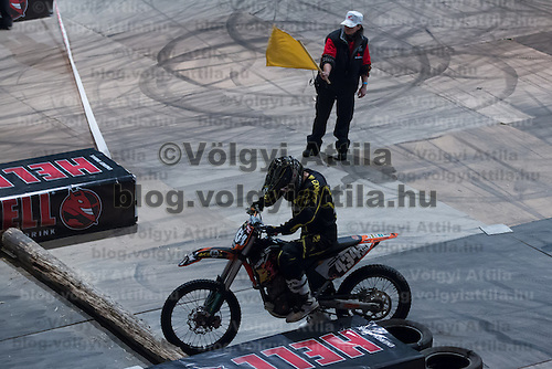 Akos Vidovics from Hungary tries to restart his bike while he competes during the Indoor Super Moto-Cross race in Budapest, Hungary on February 4, 2012. ATTILA VOLGYI