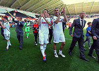 FAO SPORTS PICTURE DESK<br /> Pictured L-R: Gylfi Sigurdsson and Steven Caulker thanking supporters at the end of the game. Sunday, 13 May 2012<br /> Re: Premier League football, Swansea City FC v Liverpool FC at the Liberty Stadium, south Wales.