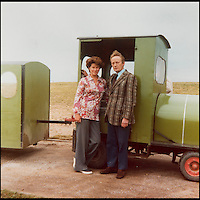 BNPS.co.uk (01202 558833)<br /> Pic: JoyceFaris/BNPS<br /> <br /> ***Please use full byline***<br /> <br /> Joyce and Roger Faris in the 1970s with the train. <br /> <br /> There was outrage today after a family that has run one of Britain's first 'Noddy' land trains for 46 years were served with a notice to quit the service.<br /> <br /> The much-loved novelty train that carries people to a remote beach was started in 1968 by the late Roger Faris, who hand-built the carriages himself.<br /> <br /> Since his death 34 years ago his widow Joyce, 88, has operated the independent service for 364 days a year and runs it more as a hobby than a profitable business.<br /> <br /> The little train has been used by generations of people and become a popular fixture at the Hengistbury Head beauty spot in Dorset.<br /> <br /> Now after five decades of service, town hall officials have told Mrs Faris they will not be renewing their contract with her as they intend to operate their own train service.