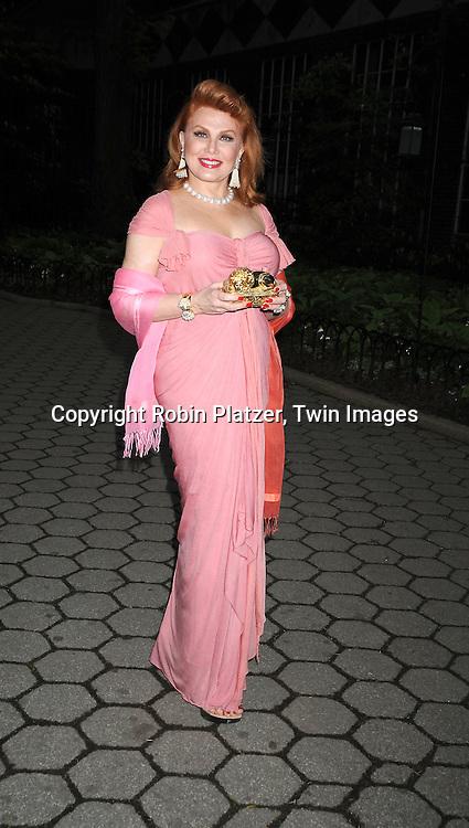 Georgette Mosbacher in Donna Karan pink dress
