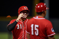 AZL Reds Wendell Marrero (31) talks to manager Jose Nieves (15) during an Arizona League game against the AZL Athletics Green on July 21, 2019 at the Cincinnati Reds Spring Training Complex in Goodyear, Arizona. The AZL Reds defeated the AZL Athletics Green 8-6. (Zachary Lucy/Four Seam Images)