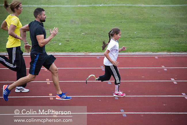 Sofia Crockatt (8) training for the Mini Great North Run with her coaches  Vicky Huyton and James Walkington at Stanley Park Arena in Blackpool. Sofia, from Leyland, Lancashire had to have her leg amputated after contracting meningitis as a baby. She is running in the race to raise money for the charity Meningitis Research Foundation.