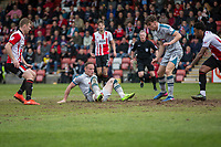 Ben Davies of Grimsby falls on the ball and a scramble ensues during the Sky Bet League 2 match between Cheltenham Town and Grimsby Town at the The LCI Rail Stadium,  Cheltenham, England on 17 April 2017. Photo by PRiME Media Images / Mark Hawkins.