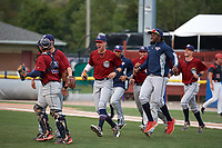 Mahoning Valley Scrappers players, including Jonathan Teaney (30), Jason Rodriguez (20), Nolan Jones (10), Francisco Perez (jacket), and Ernie Clement (24) celebrate winning the division title during the second game of a doubleheader against the Batavia Muckdogs on September 4, 2017 at Dwyer Stadium in Batavia, New York.  Mahoning Valley defeated Batavia 6-2 to clinch the Pinckney Division Title.  (Mike Janes/Four Seam Images)