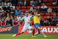 Adam Armstrong (Barnsley, loan from Newcastle United) of England battles Lyanco (Captain) of Brazil during the International match between England U20 and Brazil U20 at the Aggborough Stadium, Kidderminster, England on 4 September 2016. Photo by Andy Rowland / PRiME Media Images.