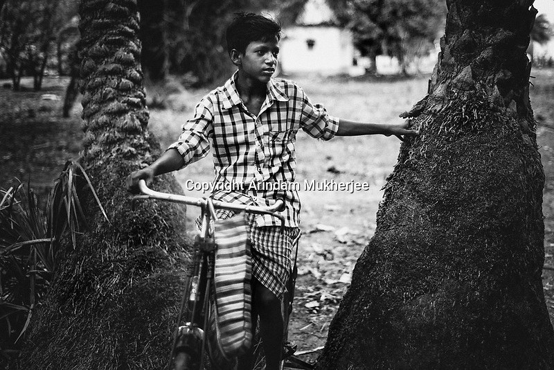 A tribal boy comes back from the weekly market at Sukma. Sukma, Chattisgarh, India. Arindam Mukherjee