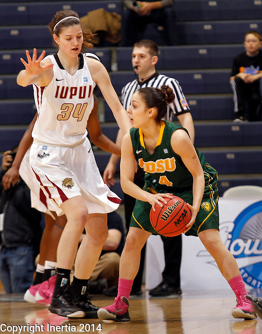 SIOUX FALLS, SD - MARCH 8:  Brooke Lemar #4 of North Dakota State looks past IUPUI defender Nevena Markovic #34 during their game at the 2014 Summit League Basketball Championships at the Sioux Falls Arena.  (Photo by Dick Carlson/Inertia)