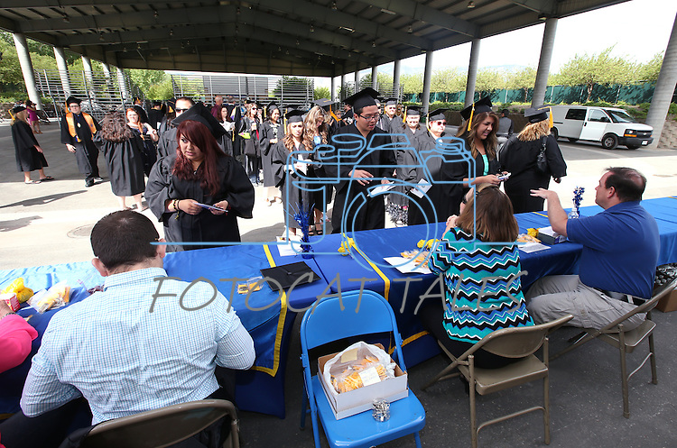 Graduates check in before the Western Nevada College commencement at the Pony Express Pavilion, in Carson City, Nev., on Monday, May 19, 2014. <br /> Photo by Cathleen Allison/Nevada Photo Source