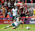 Paul Coutts of Sheffield Utd leaps over Joe Williams of Barnsley during the Championship League match at Bramall Lane Stadium, Sheffield. Picture date 19th August 2017. Picture credit should read: Simon Bellis/Sportimage