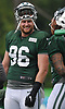 Henry Anderson #96 of the New York Jets, left, laughs with teammate Leonard Williams #92 during training camp at the Atlantic Health Jets Training Center in Florham Park, NJ on Monday, Aug. 6, 2018.