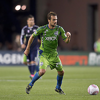Seattle Sounders forward Roger Levesque (24) dribbles. In a Major League Soccer (MLS) match, the Seattle Sounders FC defeated the New England Revolution, 2-1, at Gillette Stadium on October 1, 2011.
