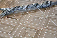 Truman, a stone waterjet mosaic shown in Driftwood polished, is part of the Parquet Line by New Ravenna.