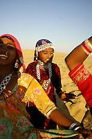 womans dance in desert dunes, evening time, Rajastan, about 40km west of Jaisalmer