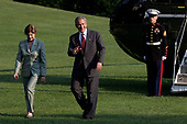 United States President George W. Bush (C), and first lady Laura Bush (L), wave to the press as they arrive at The White House aboard Marine One from Crawford, Texas, June 18, 2006, in Washington, D.C. <br /> Credit: Andrew Councill / Pool via CNP