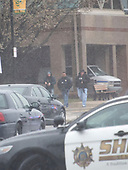 Heavily armed police officers at the front of Great Mills High School in Great Mills, Maryland where two students were wounded and one student was killed on Tuesday, March 20, 2018. <br /> Credit: Ron Sachs / CNP<br /> (RESTRICTION: NO New York or New Jersey Newspapers or newspapers within a 75 mile radius of New York City)