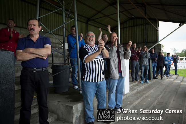 Elgin City 3 Edinburgh City 0, 13/08/2016. Borough Briggs, Scottish League Two. Home supporters applauding their team's third goal at Borough Briggs, home to Elgin City, on the day they played SPFL2 newcomers Edinburgh City (in yellow). Elgin City were a former Highland League club who were elected to the Scottish League in 2000, whereas Edinburgh City became the first club to gain promotion to the League by winning the Lowland League title and subsequent play-off matches in 2015-16. This match, Edinburgh City's first away Scottish League match since 1949, ended in a 3-0 defeat, watched by a crowd of 610. Photo by Colin McPherson.