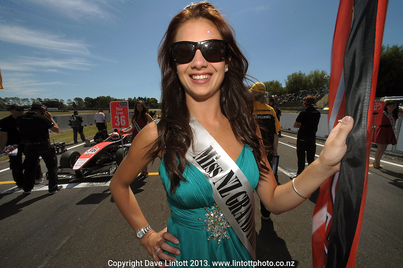 Miss NZ Grand Prix grid girls mark the driver positions before the New Zealand Grand Prix Toyota Racing Series race at Manfeild Autocourse, Feilding, New Zealand on Sunday, 10 February 2013. Photo: Dave Lintott / lintottphoto.co.nz