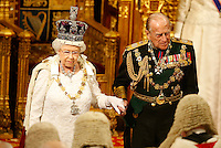 18 May 2016 - London England - Queen Elizabeth II with Prince Phillip Duke of Edinburgh look at the assembled lawmakers after she read the Queen's Speech from the throne during the State Opening of Parliament in the House of Lords in London. The State Opening of Parliament marks the formal start of the parliamentary year and the Queen's Speech sets out the government's agenda for the coming session. Photo Credit: ALPR/AdMedia