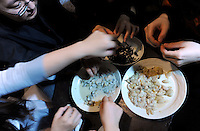 Bee larvae are prepared at a bug eating party in Tokyo, Japan. The bug eating movement is gaining in popularity in Japan where bug eating gourmet cooking parties are sold-out.  The insects are seen as the ultimate challenge in the world's gastronomical capitol but alo seen as an important alternative source of protein for the future and even the Japanese Space Program is looking into using insects as food in space travel.
