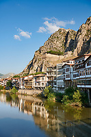 Ottoman villas of Amasya along the banks of the river Yeşilırmak, below the Pontic Royal rock tombs and mountain top ancient citadel, Turkey
